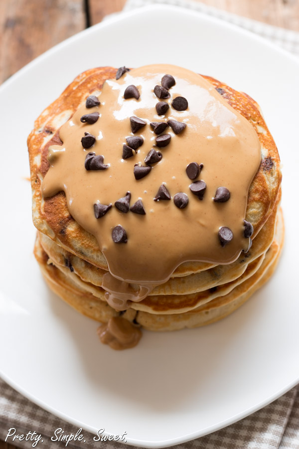 Thick peanut butter pancakes loaded with chocolate chips and drizzled with melted, warm peanut butter. | prettysimplesweet.com