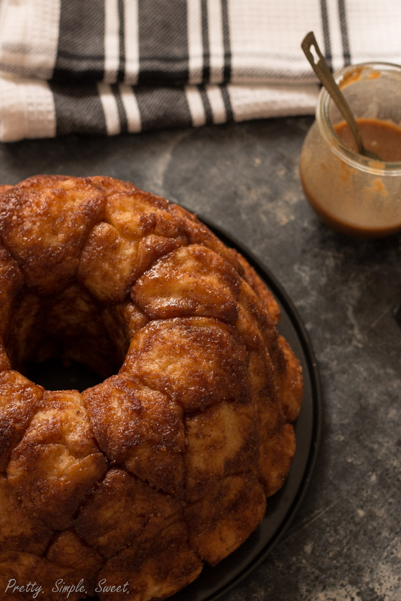 Monkey bread is made of fluffy dough balls coated in brown sugar and cinnamon, and it tastes even better than cinnamon rolls! | prettysimplesweet.com