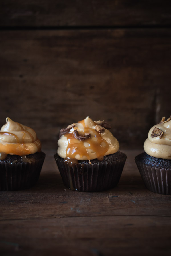 Moist chocolate cupcakes topped with a creamy peanut butter frosting | prettysimplesweet.com