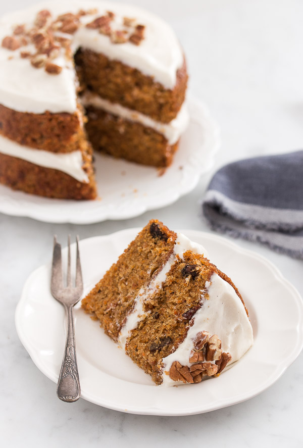 The ultimate layered carrot cake - incredibly moist, fluffy, and flavorful, and topped with the most amazing cream cheese frosting. | prettysimplesweet.com
