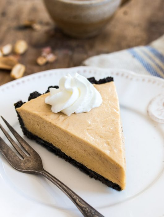 Dreamy, creamy classic peanut butter pie made of chocolate cookie crust and a fluffy peanut butter mousse filling. | prettysimplesweet.com