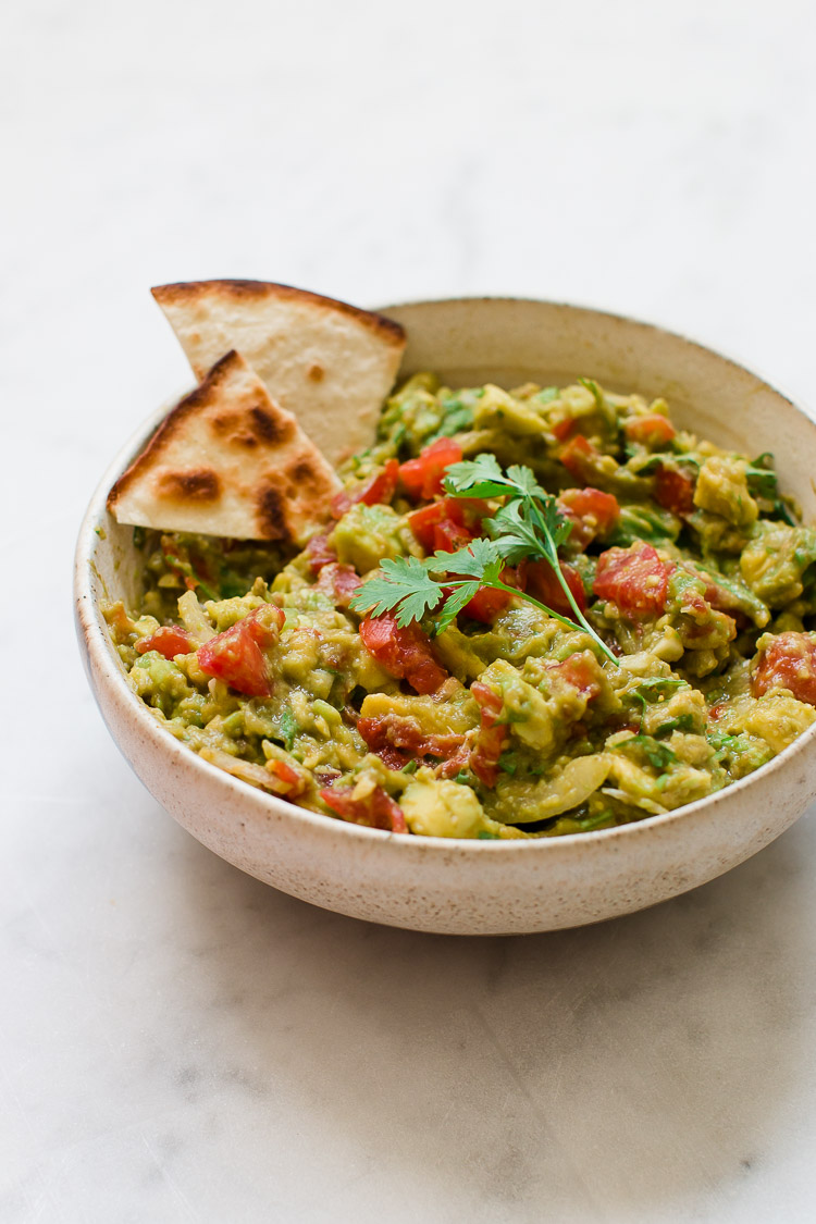 Super easy guacamole recipe pretty simple sweet guacamole is a simple quick fresh and tasty dip to make when entertaining you can serve it with tortilla chips or quesadilla wedges and make it smooth forumfinder Choice Image