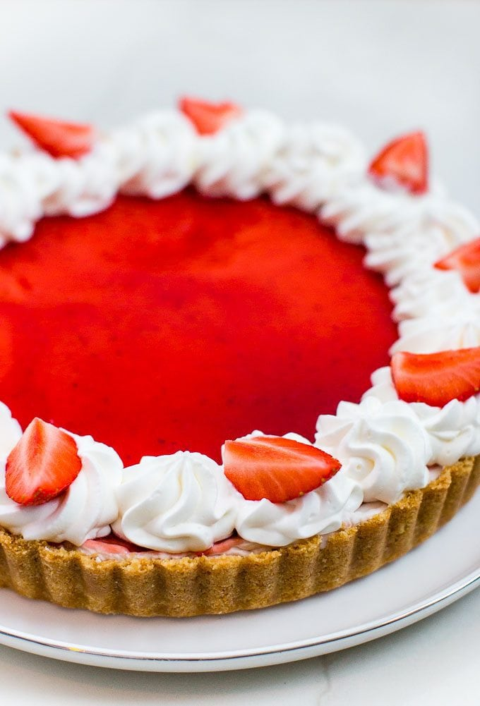 Easy and impressive no-bake strawberry and white chocolate tart with a simple cookie crust. This pie is perfect for Valentine's Day!