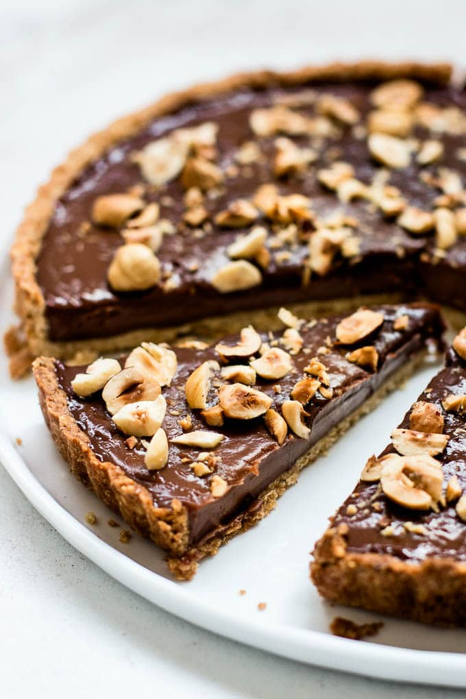 The best Nutella tart with hazelnut crust. Creamy and chocolatey with a rich chocolate hazelnut filling.