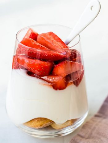 Strawberry white chocolate cheesecake in a jar. Delicious creamy white chocolate cream cheese mousse with fresh strawberries.