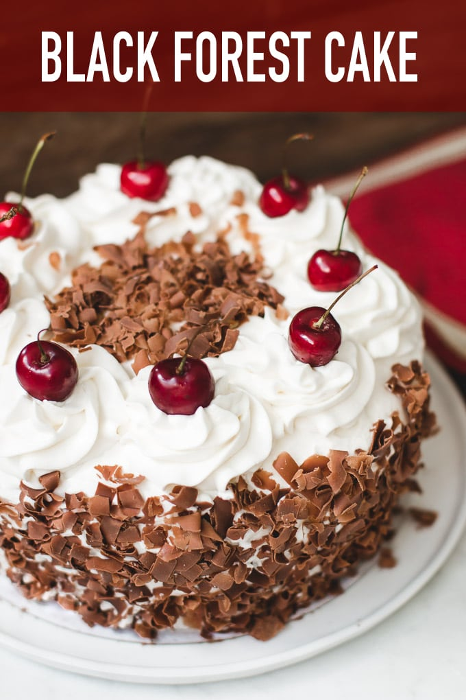 Super moist and flavorful black forest cake made with 4 layers of chocolate cake, cherries, and whipped cream.